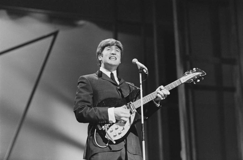 British singer-songwriter and musician John Lennon (1940 -1980) of The Beatles performing on stage at the London Palladium, UK, 13th October 1963. (Photo by Edward Wing/Daily Express/Hulton Archive/Getty Images)