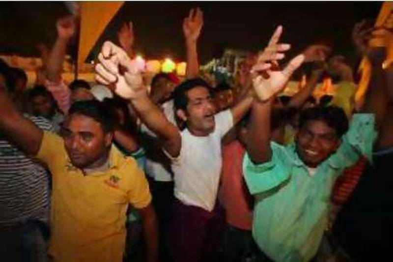 """United Arab Emirates -Dubai- Aug. 13, 2009:  ARTS & LIFE: Construction company laborers working in the UAE sing-a-long and dance to songs in the audience of the Camp ka Champ Antakshari Contest (cq-al), a singing contest akin to """"American Idol,"""" at Al Nasr Leisureland in Dubai on Thursday, Aug. 13, 2009. Amy Leang/The National  *** Local Caption ***  amy_081309_campkachamp_02.jpg"""