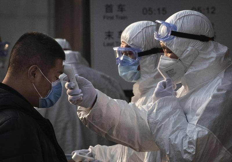 BEIJING, CHINA - JANUARY 25: A Chinese health worker checks the temperature of a woman entering a subway station during the Chinese New Year and Spring Festival on January 25, 2020 in Beijing, China. The number of cases of a deadly new coronavirus rose to over 1300 in mainland China Saturday as health officials locked down the city of Wuhan earlier in the week in an effort to contain the spread of the pneumonia-like disease which medicals experts have been confirmed can be passed from human to human. In an unprecedented move, Chinese authorities put travel restrictions on the city of Wuhan and neighbouring cities affecting a population of over 35 million. The number of those who have died from the virus in China climbed to at least 41 on Saturday and cases have been reported in other countries including the United States, Australia, France, Thailand, Japan, Taiwan and South Korea. (Photo by Kevin Frayer/Getty Images)