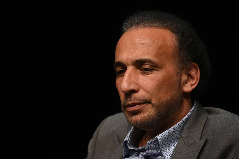 """(FILES) This file photo taken on March 26, 2016 shows Swiss Islamologist Tariq Ramadan takes part in a conference on the theme """"Live together"""", in Bordeaux. State prosecutor's office asked for the detention of Islamic scholar Tariq Ramadan, over claims by two women that he raped them in French hotel rooms in 2009 and 2012, according to information from a legal source released on February 2, 2018. / AFP PHOTO / MEHDI FEDOUACH"""