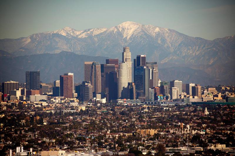 Downtown Los Angeles Skyline with the snow capped mountains in the background. Taken from Kenneth Hahn State Park. Getty Images