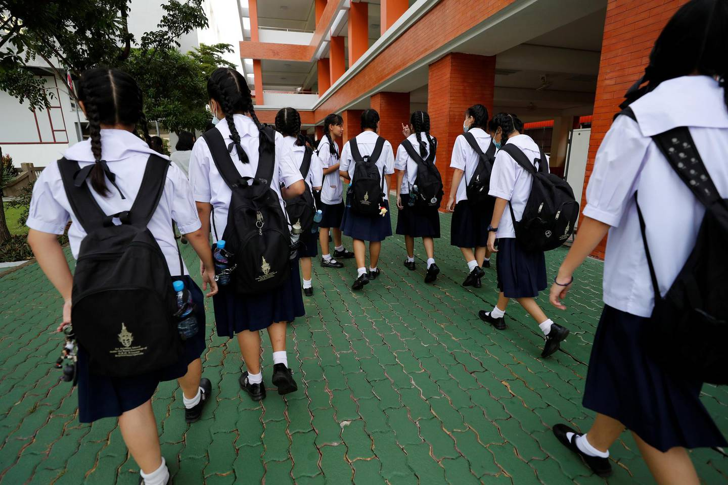 Girls walk to their classrooms before the start of their lesson day in Bangkok, Thailand September 15, 2020. Picture taken September 15, 2020. REUTERS/Jorge Silva