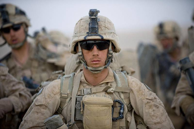 (FILES) In this file photo US Marines from the 2nd Battalion, 8th Marine Regiment of the 2nd Marine Expeditionary Brigade wait for helicopter transport as part of Operation Khanjar at Camp Dwyer in Helmand Province in Afghanistan on July 2, 2009.   President Joe Biden's decision to withdraw foreign troops from Afghanistan ushers in a new set of risks for the United States and its military. Officially, the Pentagon supports the US president's decision to end America's longest war. But many senior US commanders have been voicing their misgivings for months.   / AFP / MANPREET ROMANA