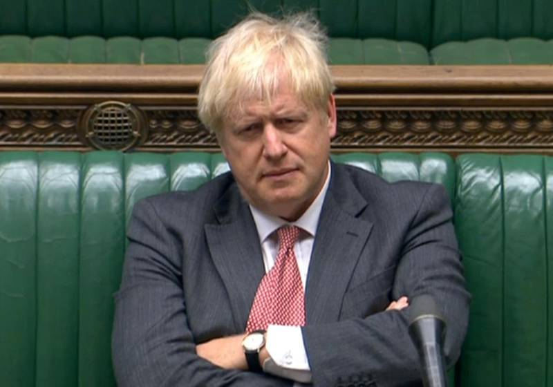 """A video grab from footage broadcast by the UK Parliament's Parliamentary Recording Unit (PRU) shows Britain's Prime Minister Boris Johnson listening as Britain's main opposition Labour Party Shadow Business, Energy and Industrial Strategy Secretary Ed Miliband (unseen) speaks in the debate into the Government's proposed Internal Markets Bill, in the House of Commons in London on September 14, 2020. - Prime Minister Boris Johnson was set to face down critics on Monday to argue in favour of a new law that his government openly admits will break its EU divorce treaty, as wrangling over Brexit returns to the British parliament. Furious officials in Brussels have demanded the proposed legislation is withdrawn before the end of the month, and Johnson is facing threats of rebellion and resignations. (Photo by - / PRU / AFP) / RESTRICTED TO EDITORIAL USE - MANDATORY CREDIT """" AFP PHOTO / PRU """" - NO USE FOR ENTERTAINMENT, SATIRICAL, MARKETING OR ADVERTISING CAMPAIGNS"""