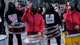 Seoul protestors wear 'Squid Games' costumes