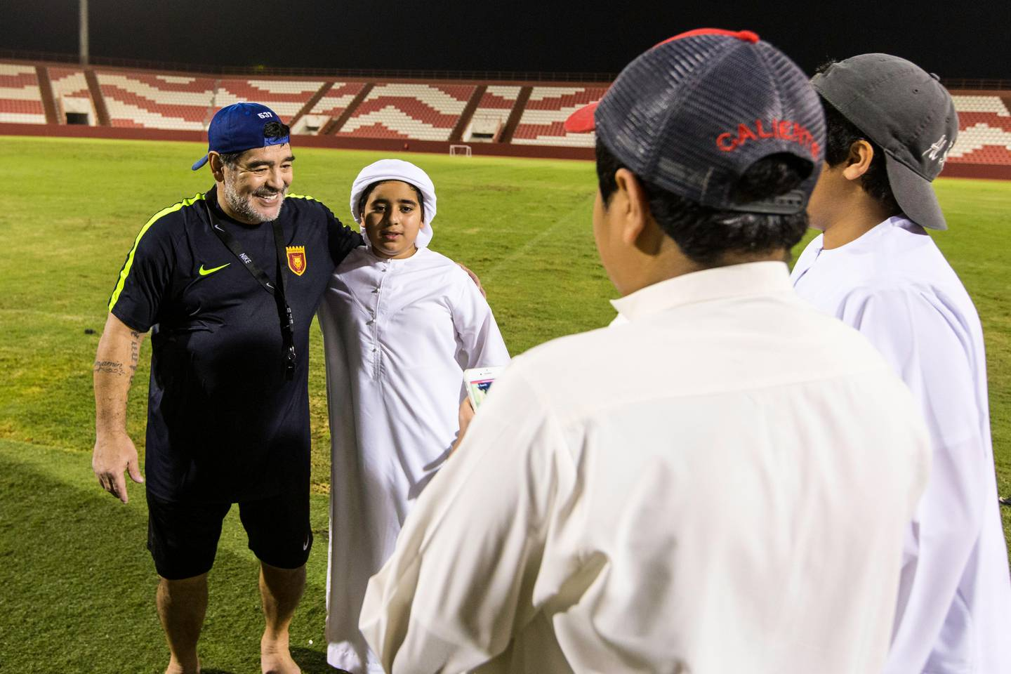 Fujairah, United Arab Emirates, July 25, 2017:    Diego Maradona, head coach of Fujairah football club, speaks with local fans after a training session ahead of the UAE first division season at the Fujairah stadium in Fujairah on July 25, 2017. Christopher Pike / The National  Reporter: John McAuley Section: Sport
