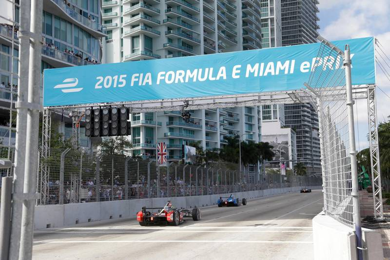 FILE - In  this March 14, 2015, file photo, cars race on downtown Miami streets during the Formula E Miami ePrix auto race, in Miami. Formula One has announced plans for a street race in Miami starting in 2019. Miami city officials are scheduled to vote next week on a plan to stage a race the series has long coveted as it seeks to enlarge its presence in the United States. A Miami race would be the second in the U.S., joining the U.S. Grand Prix in Austin, Texas. (AP Photo/Wilfredo Lee, File)