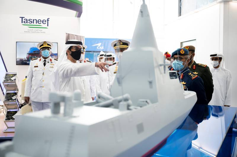 ABU DHABI, UNITED ARAB EMIRATES - February 21, 2021: HH Sheikh Hamed bin Zayed Al Nahyan, Member of Abu Dhabi Executive Council (2nd L) tours the International Defence Exhibition and Conference 2021 (IDEX), at ADNEC. Seen with HE Major General Essa Saif Al Mazrouei, Deputy Chief of Staff of the UAE Armed Forces (R).  ( Rashed Al Mansoori / Ministry of Presidential Affairs ) ---
