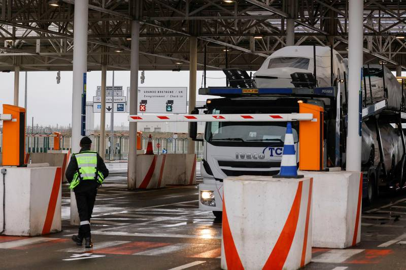 The Pit Stop at the Eurotunnel, where lorries are checked before boarding the Shuttle Freight from France to Britain, is seen in Coquelles near Calais, after France barred all people coming from the United Kingdom, for 48 hours from Sunday night, over fears of a new strain of the coronavirus, amid the spread of the coronavirus disease (COVID-19) in France, December 22, 2020. REUTERS/Pascal Rossignol