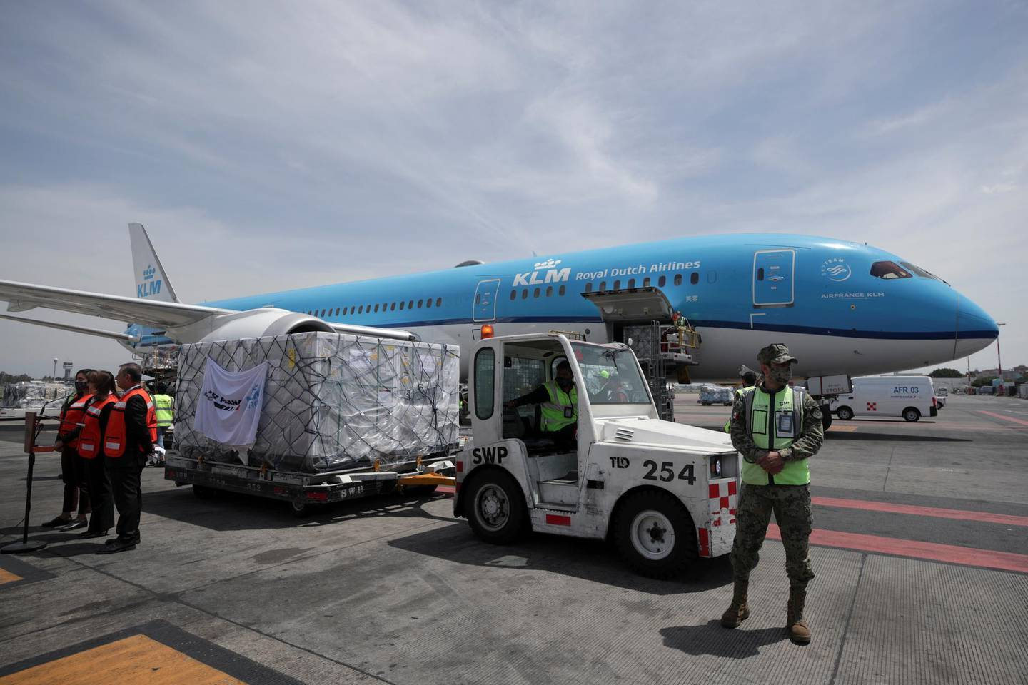 Workers unload a batch of AstraZeneca coronavirus disease (COVID-19) vaccines, delivered under the COVAX scheme, from a KLM Boeing 787 at Benito Juarez International Airport in Mexico City, Mexico May 27, 2021. REUTERS/Henny Romero