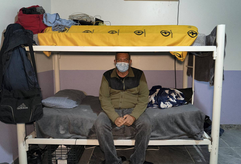 Roberto Rivas sits in his bunk bed at Casa Del Emigrante Senda De Vida. Willy Lowry/ The National