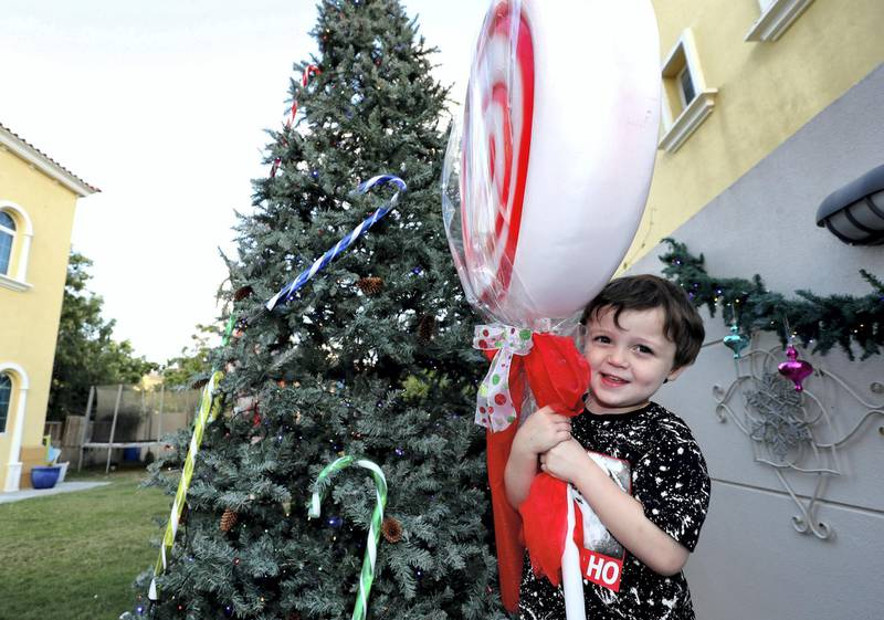 Dubai, United Arab Emirates - December 08, 2020: Christmas. Festive decorations by UAE residents. Lucy Gregory's house. Baxter aged 4. Tuesday, December 8th, 2020 in Dubai. Chris Whiteoak / The National