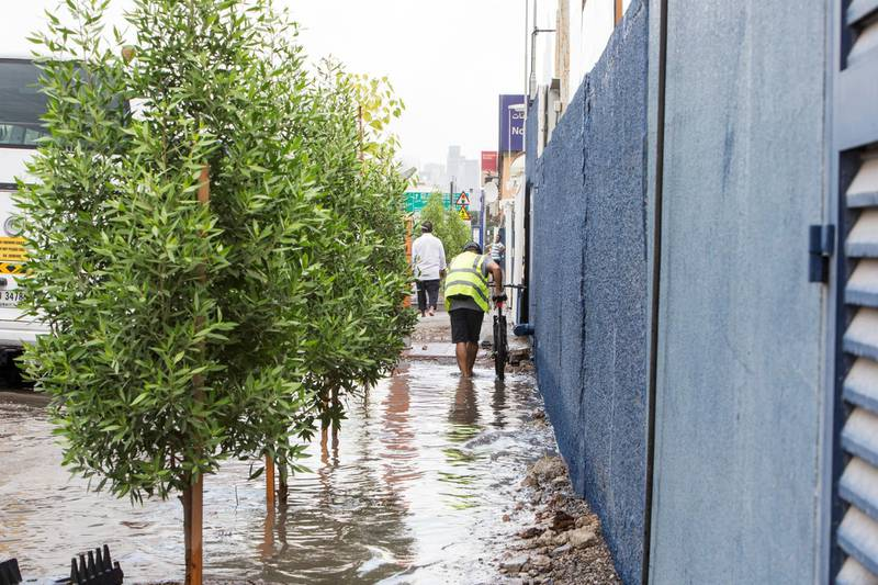 Dubai, United Arab Emirates - Flooded street due to rain today in Al Quoz Industrial area.  Leslie Pableo for The National