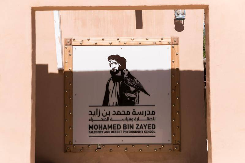 ABU DHABI, UNITED ARAB EMIRATES - DEC 6, 2017  MBZ Falconry and Desert Physiognomy School signage at the Telal Resort, where the fourth International Festival of Falconry is happening.  The gathering this year is a tribute to a similar meeting 41 years ago, in 1976, when the UAE Founding Father Sheikh Zayed invited falconers from around the world to convene in the desert of Abu Dhabi and build a strategy for the sport's development.  (Photo by Reem Mohammed/The National)  Reporter: Anna Zacharias Section: NA