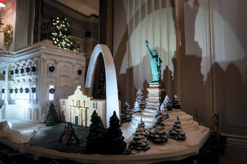 """WASHINGTON, DC - DECEMBER 2 : Gingerbread house featuring the White House and landmarks from across the country are seen in the State Dining Room at the White House on Monday, Dec 02, 2019 in Washington, DC. """"This year's theme, The Spirit of America, is a tribute to the traditions, customs, and history that make our Nation great. Designed by First Lady Melania Trump, the White House decorations celebrate the courageous individuals who have shaped our country and kept the American spirit alive."""" (Photo by Jabin Botsford/The Washington Post via Getty Images)"""