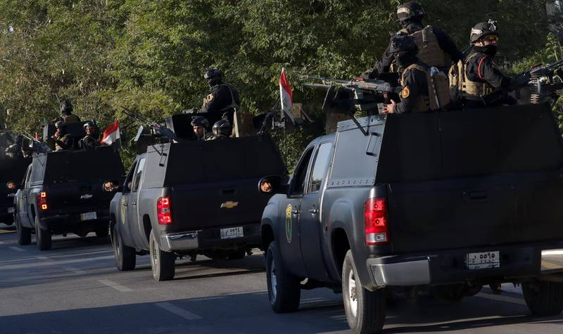 Iraqi security forces patrol near the Chaldean Cathedral of Saint Joseph where Pope Francis is expected to concelebrate mass in, in Baghdad, Iraq, Saturday, March 6, 2021. Earlier today Francis met privately with the country's revered Shiite leader, Grand Ayatollah Ali al-Sistani. (AP Photo/Andrew Medichini)