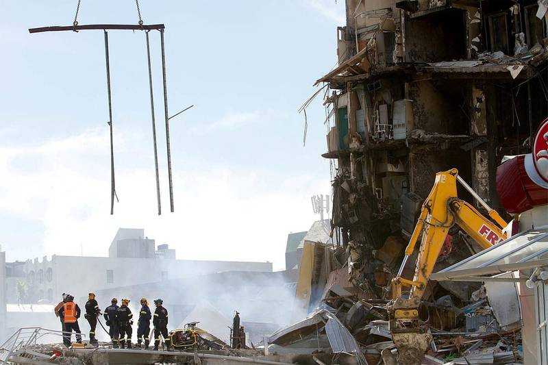 February 24, 2011 of rescuers standing at the smoking ruins of the Canterbury TV (CTV) building which collapsed during the 6.3 magnitude earthquake in Christchurch. AFP