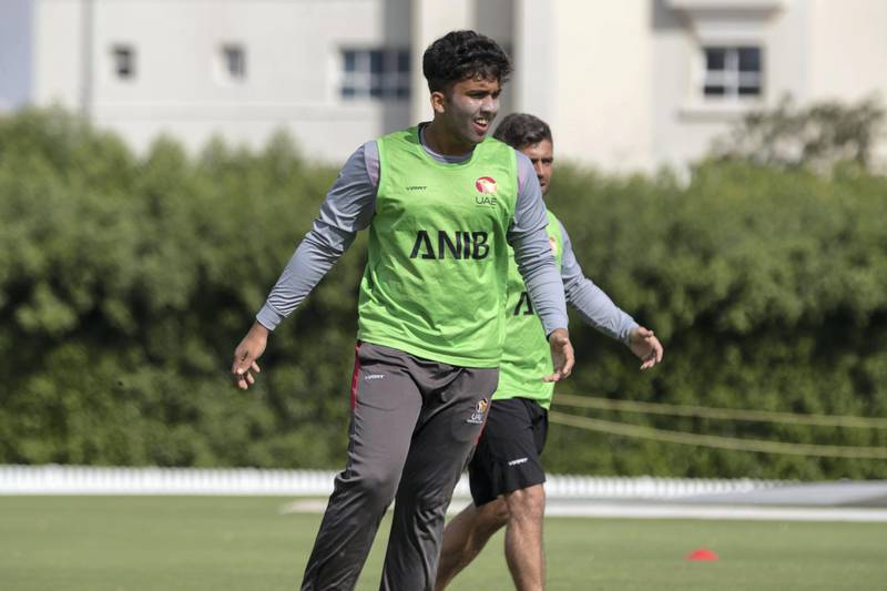 SHARJAH, UNITED ARAB EMIRATES. 31 DECEMBER 2019. The UAE U19 cricket team training at the ICC Academy in Sports City ahead of their trip to the World Cup in South Africa. Player Alishan Sharafu in the green vest. (Photo: Antonie Robertson/The National) Journalist: Paul Radley. Section: National.