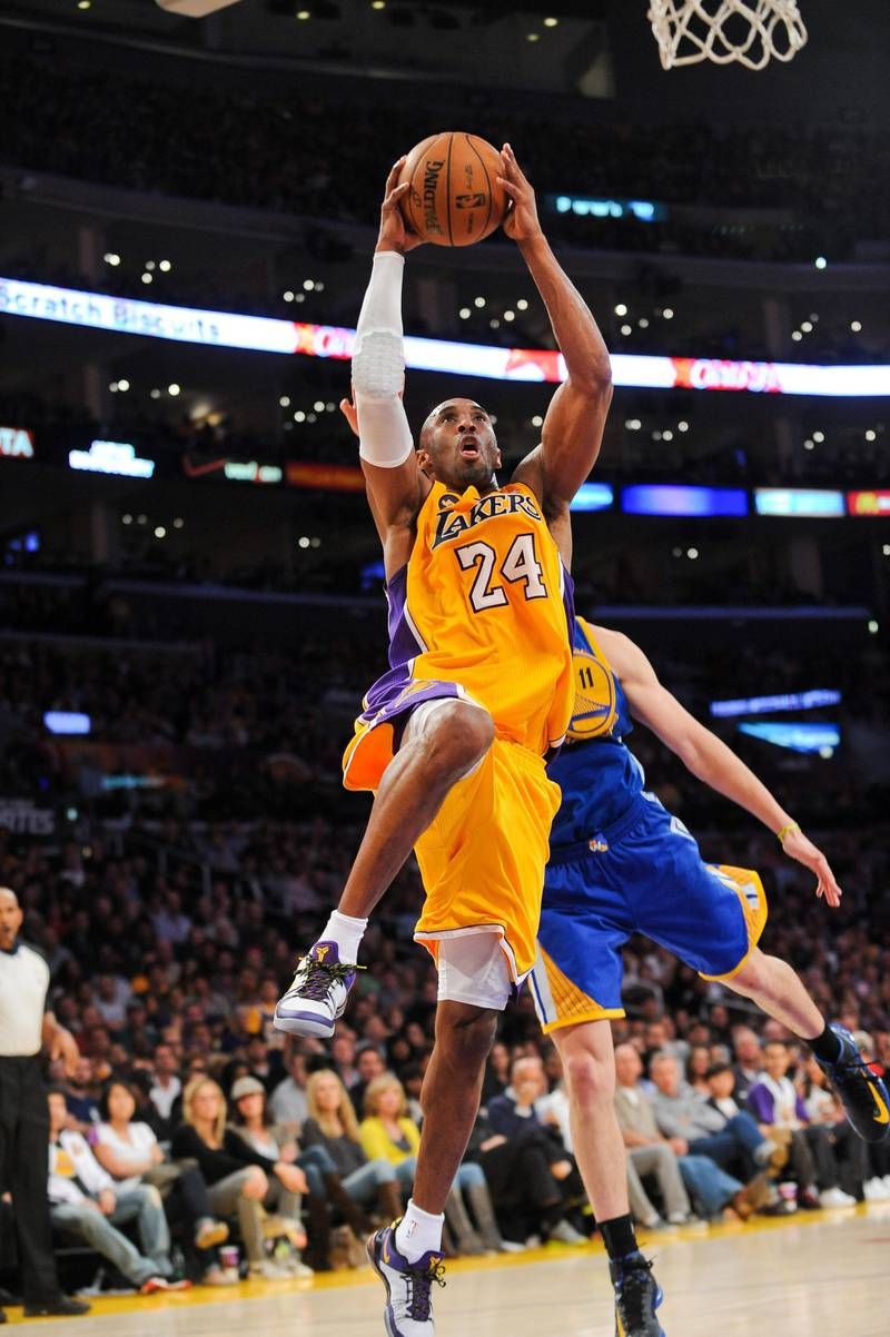 LOS ANGELES, CA - APRIL 12: Kobe Bryant #24 of the Los Angeles Lakers rises for a dunk against the Golden State Warriors at Staples Center on April 12, 2013 in Los Angeles, California. NOTE TO USER: User expressly acknowledges and agrees that, by downloading and/or using this Photograph, user is consenting to the terms and conditions of the Getty Images License Agreement. Mandatory Copyright Notice: Copyright 2013 NBAE   Noah Graham/NBAE via Getty Images/AFP