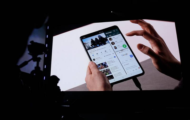 Features of the new Samsung Galaxy Fold smartphone are displayed during an event Wednesday, Feb. 20, 2019, in San Francisco. Samsung is hailing the 10th anniversary of its first smartphone with three new models that seem unlikely to reverse a sales slump in an industry recycling the same ideas. The S10 line-up unveiled Wednesday in San Francisco all boast fancy cameras, sleek screens covering the entire front of the device and at least 128 gigabytes of storage, the most important features to consumers looking for a new smartphone. (AP Photo/Eric Risberg)