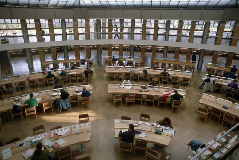 Students study in a new library at Cambridge University. England, UK. Getty Images