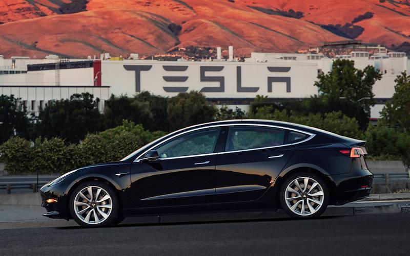 FILE - This file image provided by Tesla Motors shows the Tesla Model 3 sedan. Tesla is raising $1.5 billion as it ramps up production of its Model 3 sedan, its first mass market electric car, the company said Monday, Aug. 7, 2017. (Courtesy of Tesla Motors via AP, File)