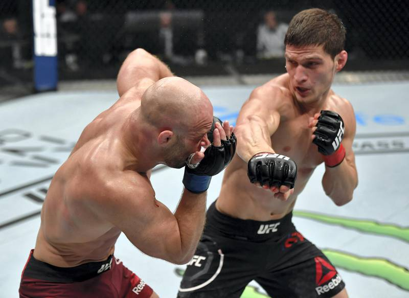 ABU DHABI, UNITED ARAB EMIRATES - JULY 26: (R-L) Movsar Evloev of Russia punches Mike Grundy of England in their featherweight fight during the UFC Fight Night event inside Flash Forum on UFC Fight Island on July 26, 2020 in Yas Island, Abu Dhabi, United Arab Emirates. (Photo by Jeff Bottari/Zuffa LLC via Getty Images) *** Local Caption *** ABU DHABI, UNITED ARAB EMIRATES - JULY 26: (R-L) Movsar Evloev of Russia punches Mike Grundy of England in their featherweight fight during the UFC Fight Night event inside Flash Forum on UFC Fight Island on July 26, 2020 in Yas Island, Abu Dhabi, United Arab Emirates. (Photo by Jeff Bottari/Zuffa LLC via Getty Images)