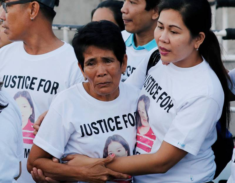 Family members wait for the arrival of the body of Joanna Demafelis, a Filipina domestic helper who was killed and found inside a freezer in Kuwait, in her hometown in Iloilo province in the Philippines February 17, 2018.  REUTERS/Erik De Castro