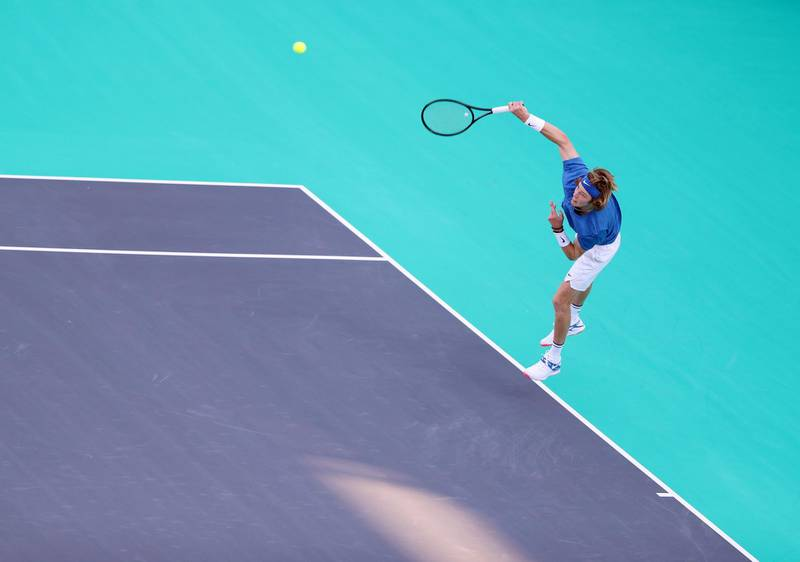 Abu Dhabi, United Arab Emirates - Reporter: Jon Turner: Andrey Rublev serves during the fifth place play-off between Andrey Rublev v Hyeon Chung at the Mubadala World Tennis Championship. Friday, December 20th, 2019. Zayed Sports City, Abu Dhabi. Chris Whiteoak / The National