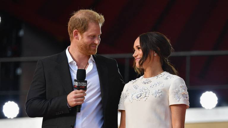 An image that illustrates this article Prince Harry and Meghan get interrupted by cheering crowds while urging vaccine equity