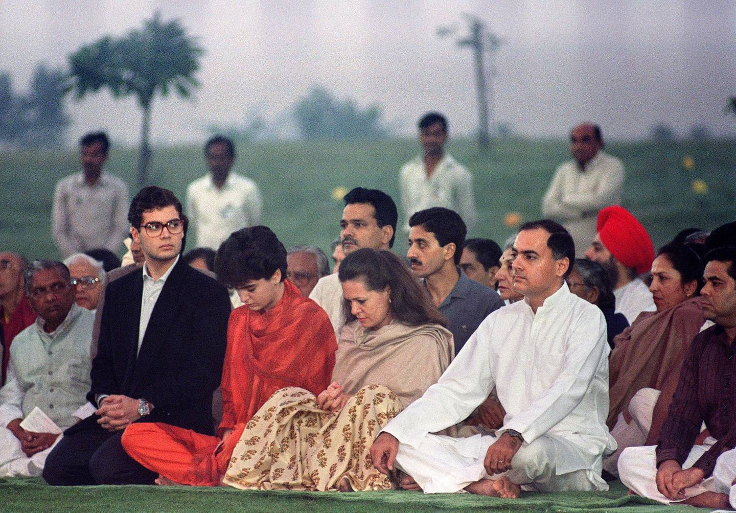 India's Premier Rajiv Gandhi (2nd-R), accompanied by his Italian-born wife Sonia (C) and his daughter Priyanka (2nd-L) and son Rahul (L), pray, on his mother, Indira Gandhi's, cremation site 31 October 1989 in New Delhi. Indira, a Congress party leader, was brutally assassinated by Sikh militants in 1984, a tragedy which thrust power onto Rajiv, who was then a commercial pilot of Indians Airlines. On 21 May 1991, Rajiv Gandhi, then Indian Prime minister, was assassinated by a woman activist allegedly belonging to Sri Lankan Liberation Tigers of Tamil Eelam (LTTE) rebels. Sonia, eleven years after the assassination of Rajiv, is leading a revival of the Congress party and carrying forward the legacy of India's most powerful political dynasty. AFP PHOTO DOUGLAS E. CURRAN (Photo by DOUGLAS E. CURRAN / AFP)