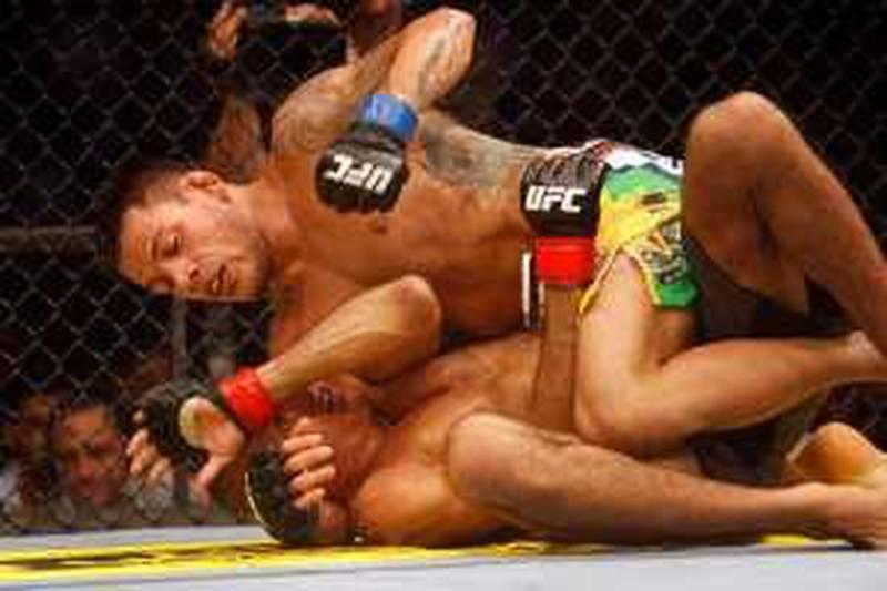 ABU DHABI. 10th April 2010. UFC. YAS ISLAND. Rafael Dos Anjos punches Terry Etim  on Yas Island last night (sat)  Stephen  Lock   /  The National