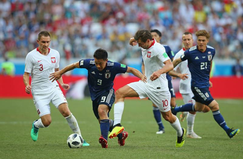 VOLGOGRAD, RUSSIA - JUNE 28:  Grzegorz Krychowiak of Poland tackles Shinji Okazaki of Japan during the 2018 FIFA World Cup Russia group H match between Japan and Poland at Volgograd Arena on June 28, 2018 in Volgograd, Russia.  (Photo by Alex Livesey/Getty Images)