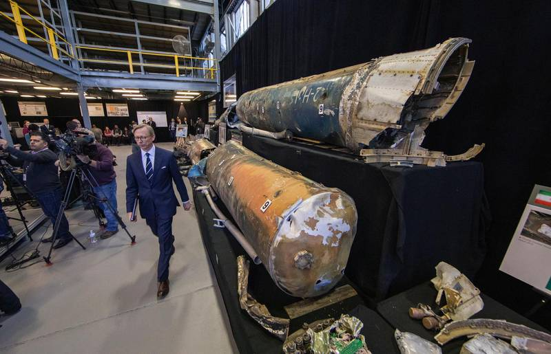 epa07197500 US Special Representative for Iran, Brian Hook (C), arrives for an 'Iranian Materiel Display' press conference in a hangar at Joint Base Anacostia-Bolling in Washington, DC, USA, 29 November 2018. Hook is walking past what are said to be recovered Iranian Qiam short range ballistic missiles.  EPA/ERIK S. LESSER