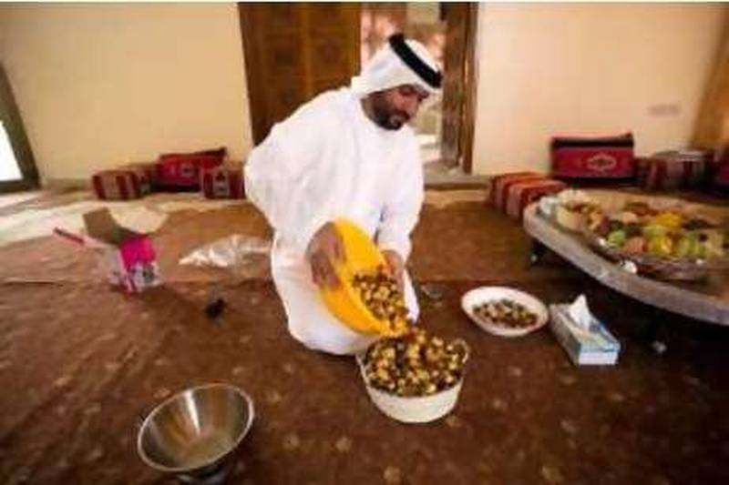 16/07/10 - Abu Dhabi, UAE -  Ahmed Al Murar checks the dates he will enter in the Liwa Date Festival.  Al Murar has won in past at the Liwa Date Festival. (Andrew Henderson/The National)