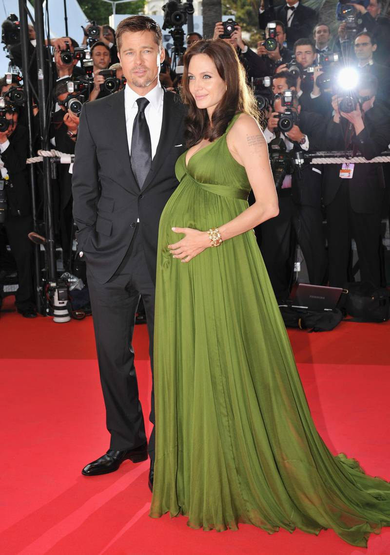 """CANNES, FRANCE - MAY 15:  Actress Angelina Jolie and Brad Pitt attend the """"Kung Fu Panda"""" premiere at the Palais des Festivals during the 61st Cannes International Film Festival on May 15, 2008 in Cannes, France.  (Photo by Pascal Le Segretain/Getty Images)"""