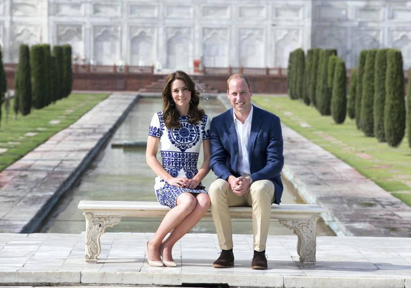 AGRA, INDIA - APRIL 16:  Prince William, Duke of Cambridge and Catherine, Duchess of Cambridge sit in front of the Taj Mahal during day seven of the royal tour of India and Bhutan on April 16, 2016 in Agra, India. This is the last engagement of the Royal couple after a week long visit to India and Bhutan that has taken them in cities such as Mumbai, Delhi, Kaziranga, Thimphu and Agra.  (Photo by  Ian Vogler - Pool/Getty Images)