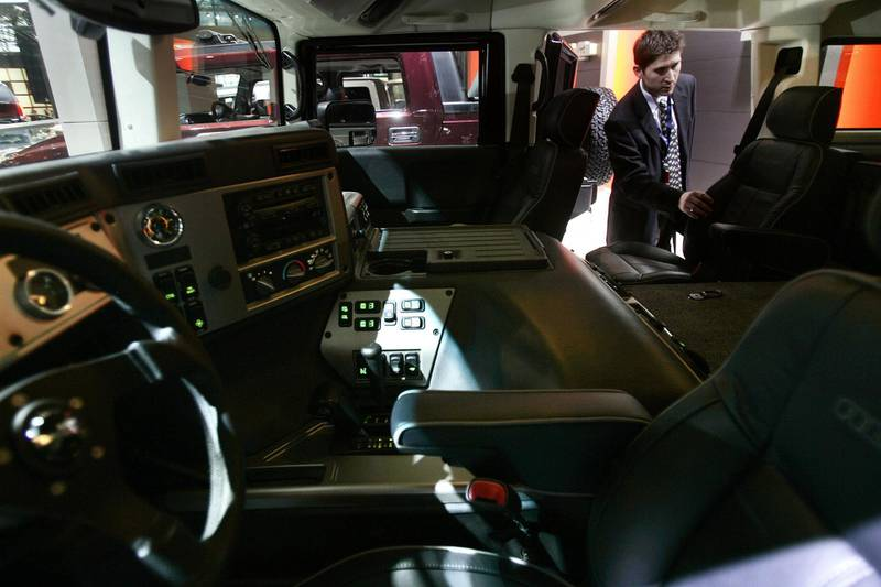 NEW YORK - APRIL 12:  A member of the press looks through the interior of a Hummer H1 Diesel on April 12, 2006 at the 2006 New York International Auto Show in New York City. The show is open to the public from April 14-23. (Photo by Chris Hondros/Getty Images)