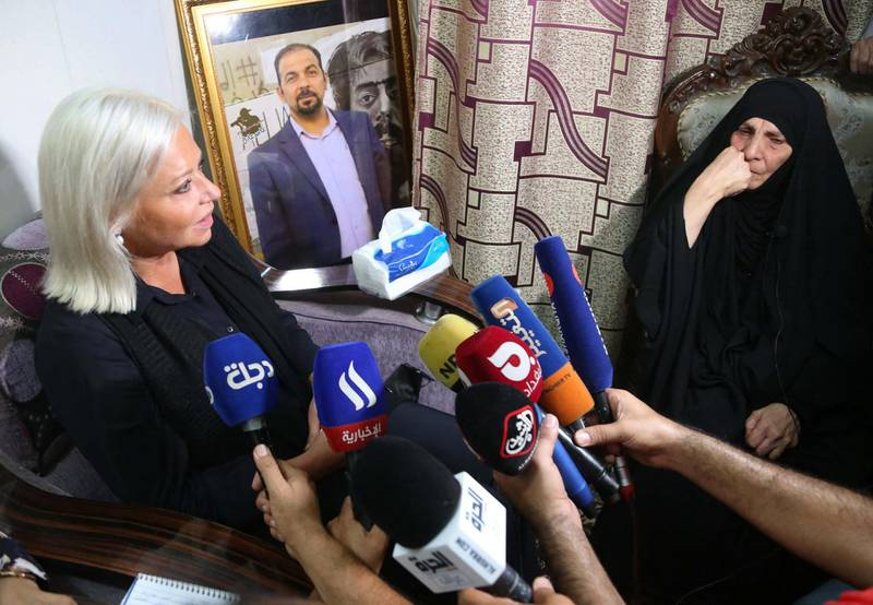 Special Representative of the Secretary-General for the United Nations Assistance Mission for Iraq, Jeanine Hennis-Plasschaert (L), visits the mother of assassinated Iraqi activist Ihab Jawad al-Wazni (image), in her home in the central city of Karbala, on June 24, 2021. Wazni, an Iraqi pro-democracy activists was shot dead on May 9 by men on motorbikes using a silencer in an ambush outside his home in the city of Karbala.   / AFP / Mohammed SAWAF