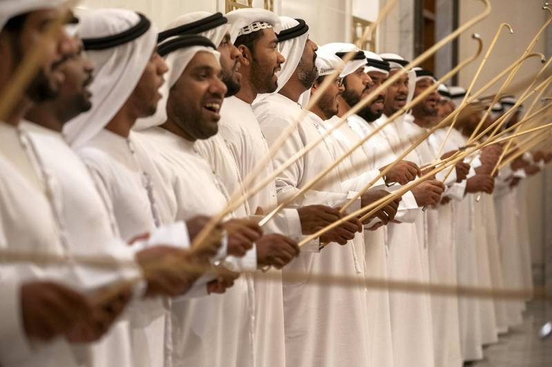 ABU DHABI, UNITED ARAB EMIRATES - February 3, 2019: Day one of the UAE papal visit - Men sing and dance during arrival of His Holiness Pope Francis, Head of the Catholic Church (not shown), and His Eminence Dr Ahmad Al Tayyeb, Grand Imam of the Al Azhar Al Sharif (not shown), at the Presidential Airport.  ( Ryan Carter / Ministry of Presidential Affairs ) ---