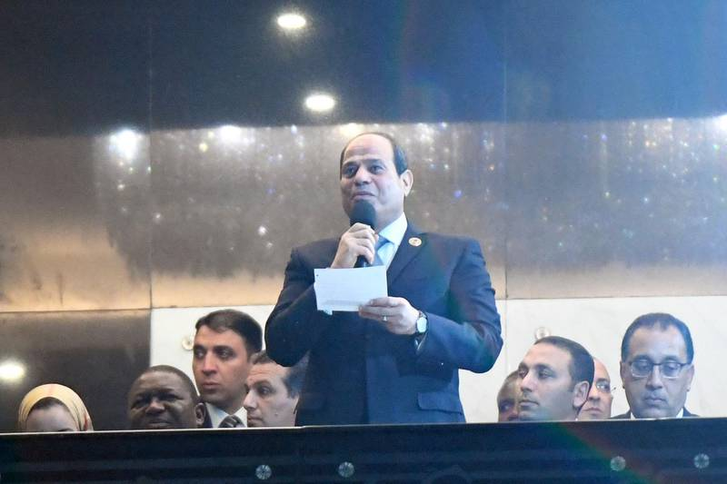 Egypt's President Abdel Fattah al-Sisi (C) delivers a speech during the opening ceremony during the 2019 Africa Cup of Nations (CAN) football match between Egypt and Zimbabwe at Cairo International Stadium on June 21, 2019.  / AFP / Khaled DESOUKI