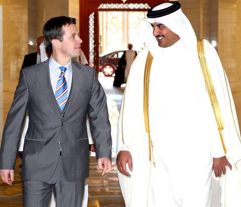 A handout picture released by the Qatari emir's office shows Qatari Crown Prince Sheikh Tamim bin Hamad al-Thani (R) greeting his Danish counterpart Frederik ahead of a meeting in Doha on January 17, 2010. The Danish crown prince is on an official visit to Qatar as part of a regional tour also including Saudi Arabia and the United Arab Emirates. AFP PHOTO/HO == RESTRICTED TO EDITORIAL USE == *** Local Caption ***  642728-01-08.jpg
