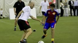 Football legend Zinédine Zidane puts children through paces in Abu Dhabi