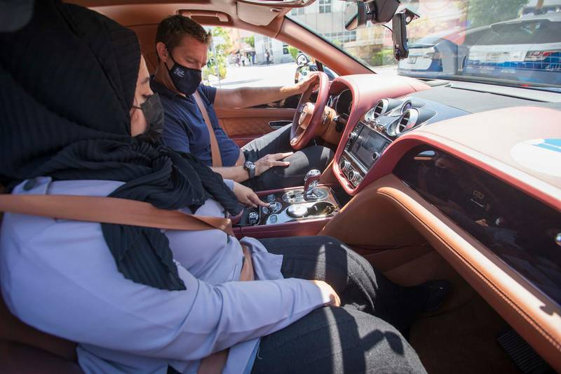 Dubai, United Arab Emirates - Driving instructor Zubeida inside a Bentley car instructing Nick Webster at the Emirates Driving Institute, Dubai.  Leslie Pableo for The National