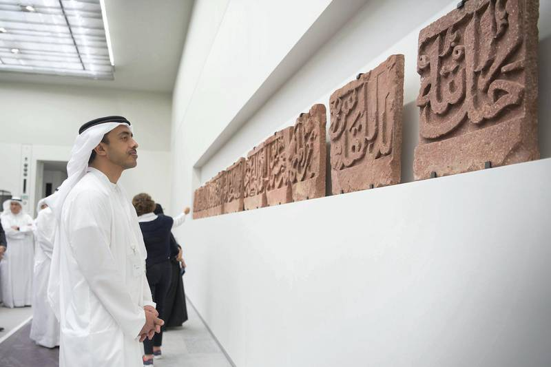 SAADIYAT ISLAND, ABU DHABI, UNITED ARAB EMIRATES -September 11, 2017: HH Sheikh Abdullah bin Zayed Al Nahyan, UAE Minister of Foreign Affairs and International Cooperation (L) views the Epigraphic frieze, during a tour of the Louvre Abu Dhabi.  ( Mohamed Al Raeesi for Crown Prince Court - Abu Dhabi ) ---