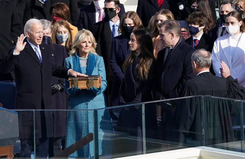 Joe Biden is sworn in as the 46th President of the United States as his spouse Jill Biden holds a bible on the West Front of the U.S. Capitol in Washington, U.S., January 20, 2021. REUTERS/Kevin Lamarque