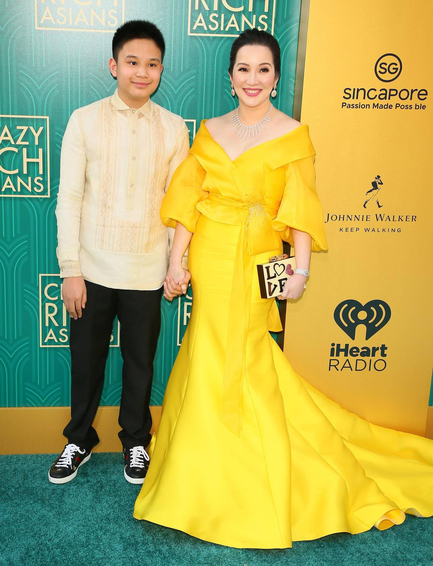 """Actress Kris Aquino (R) and her son actor Bimby Aquino Yap attends the premiere of Warner Bros Pictures' """"Crazy Rich Asians"""" in Hollywood, California, on August 7, 2018.  / AFP PHOTO / JEAN-BAPTISTE LACROIX"""