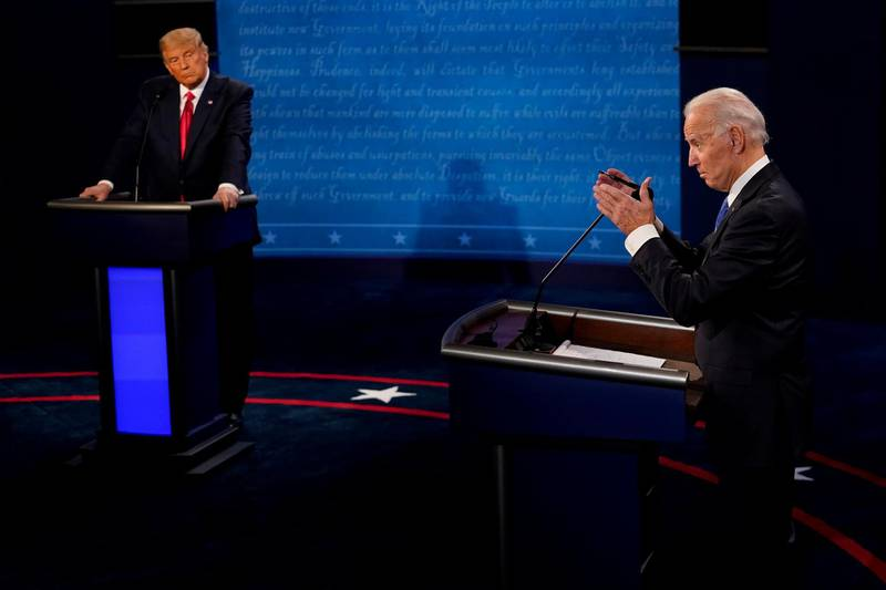 FILE PHOTO: Democratic presidential candidate former Vice President Joe Biden answers a question as President Donald Trump listens during the second and final presidential debate at the Curb Event Center at Belmont University in Nashville, Tennessee, U.S., October 22, 2020. Morry Gash/Pool via REUTERS/File Photo
