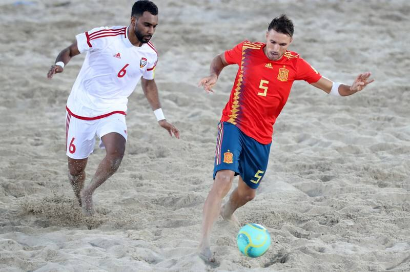 Dubai, United Arab Emirates - November 05, 2019: The UAE's Kamal Ali and Spain's Francisco Jose Cintas battle during the game between the UAE and Spain during the Intercontinental Beach Soccer Cup. Tuesday the 5th of November 2019. Kite Beach, Dubai. Chris Whiteoak / The National