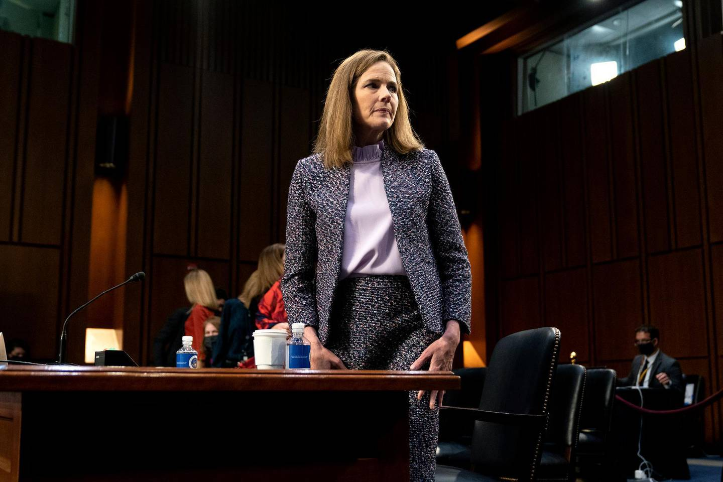 """FILE - In this Wednesday, Oct. 14, 2020 file photo, Supreme Court nominee Amy Coney Barrett departs during a break in a confirmation hearing before the Senate Judiciary Committee on Capitol Hill in Washington. On Friday, Oct. 16, 2020, The Associated Press reported on stories circulating online incorrectly asserting that when reporters asked President Donald Trump why he nominated Barrett to replace the late Supreme Court Justice Ruth Bader Ginsburg, he said Barrett is """"much better looking"""" than other women who have appeared on the court and """"if people are more attractive, they get a fantastic amount of respect."""" There is no evidence Trump made these comments. (Stefani Reynolds/Pool via AP)"""